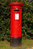 Red mail box. Red Victorian mail box in a rural village Royalty Free Stock Photography