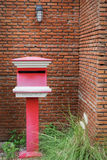 Red mail box with brick wall background Royalty Free Stock Photo