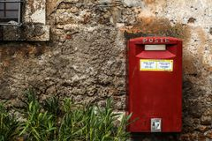 Red Mail Box Beside Green Grass Royalty Free Stock Image