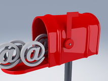 Red mail box with heap of at sign Royalty Free Stock Photos