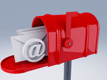 Red mail box with at symbol and heap of letters Royalty Free Stock Photo