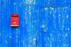 Red mail box on textured wall Stock Image