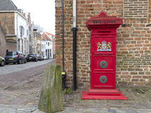 Red mail box. Traditional red mailbox with the official weapon of the kingdom of the Netherlands on it Royalty Free Stock Photo