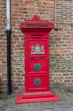 Red mail box. Traditional red mailbox with the official weapon of the kingdom of the Netherlands on it Royalty Free Stock Photography