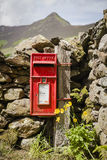 Red mail box. Typical red letter mailbox in Lake District Stock Image