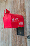 Red mail box and wood texture background. Red mail box and wood textures wallpapers backgrounds Royalty Free Stock Image