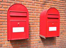 Red mail boxes on brick wall Royalty Free Stock Photo