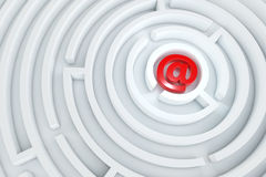 Red mail icon in the center of the maze. Red mail icon in the center of the white maze Royalty Free Stock Images