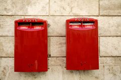Red Mailbox. On stone wall in italy Royalty Free Stock Photo