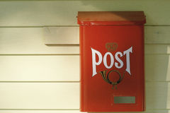Red Mailbox. Red post office box on white wood board near Westfield, NY Stock Photo