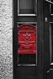 Red mailbox. Red small mailbox on wooden door Stock Photo