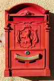 Red mailbox. With heraldry ornament Stock Photography