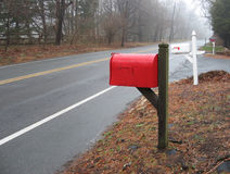 Red Mailbox. On a rural road Stock Photo