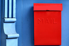Red Mailbox and Blue Column Stock Photography
