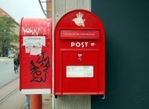 Red mailbox in Copenhagen. COPENHAGEN, DENMARK - SEPT 27, 2012 - Red mailboxes in Copenhagen, Denmark Royalty Free Stock Photo