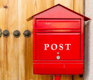 Red mailbox. In front of the house Stock Photos