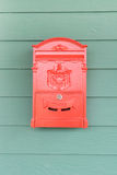 Red mailbox with green wood Royalty Free Stock Images