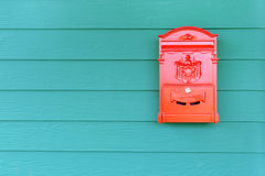 Red mailbox with green wood background Stock Image