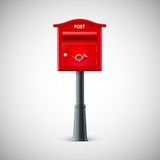 Red mailbox hanging on the wall, logo postal horn. Stock Photography