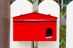 Red Mailbox With Mail Stock Photo