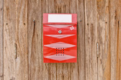 Red mailbox on old wood wall Stock Photos