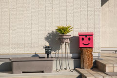 The red mailbox and pots at home in Japan Stock Image