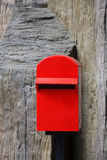 Red mailbox on rough wall Stock Photography