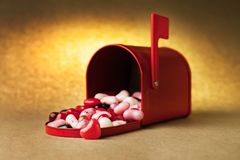 Red mailbox tin with heart candies inside. Royalty Free Stock Photos