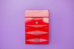 Red mailbox on violet background Stock Photo