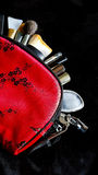 Red make up bag with brushes Royalty Free Stock Photos