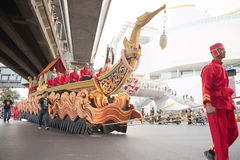 Red man dragging large boat over pathumwan intersection Royalty Free Stock Photo
