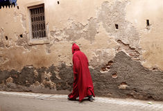 The red man. A man dressed in red is walking in fez, morocco Royalty Free Stock Image