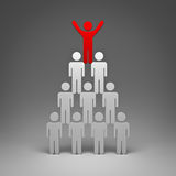 Red man standing with arms wide open up on top of pyramid Stock Photo