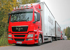 Red MAN 18.360 Truck and Full Trailer Parked stock photo