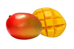 Red Mango. One and a half red mangoes, isolated on white background Royalty Free Stock Image