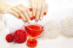 Red manicure with dekor. spa Stock Photo
