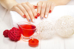 Red manicure with dekor. spa Stock Image
