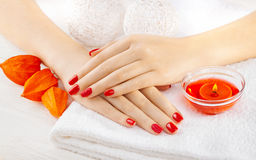 Red manicure with dekor. spa Royalty Free Stock Photo
