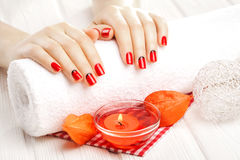 Red manicure with dekor. spa Royalty Free Stock Photos