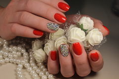 Red manicure design with ornaments royalty free stock image