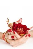 Red manicure, golden ribbon and rose Royalty Free Stock Photography