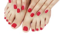 Red manicure and pedicure close-up, isolated on white background stock images