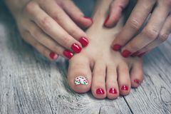 Red manicure and pedicure on vintage wooden background stock images