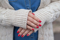 Red manicure. Woman hands with beautiful red manicure closeup Royalty Free Stock Photography