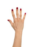 Red manicured female open hand gesture number five fingers up Stock Photos