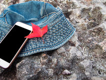Red maple leaf ,cell phone and hat Royalty Free Stock Photography