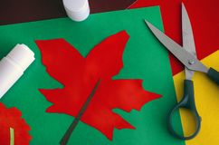 Red maple leaf. Child applique with paper, scissors and glue. Close-up Stock Photo