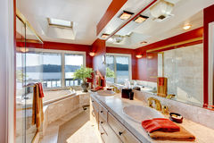 Red and marble interior of large luxury master bathroom with gla Royalty Free Stock Image