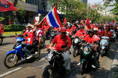 Red March. Supporters of former prime minister Thaksin Shinawatra march on Bangkok wearing red shirts, March 2010, Silom road, Bangkok, Thailand Royalty Free Stock Image