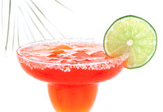 Red Margarita cocktail with mint and lime slice in chilled salt Stock Image